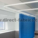 Cubicle curtain track with disposable curtains